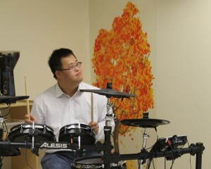 A Klema boy looks to the worship leader for a cue.
