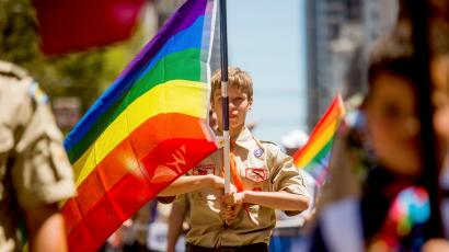 Boy Scout Holds Rainbow Flag